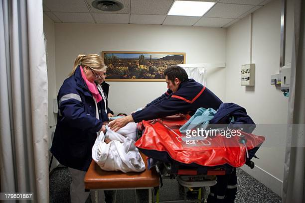 Emergency Medical Service team of Pontoise hospital France Intervention of woman suffering back pain and legs paralysis doctor suspects a cauda...