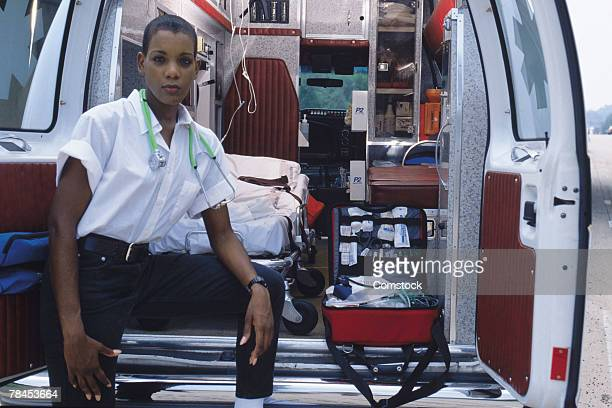 Emergency medical technician at back of ambulance