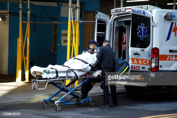 Emergency medical technicians move a COVID19 patient from Mt Sinai Morningside Hospital into an ambulance Hospitals in New York City have been hard...