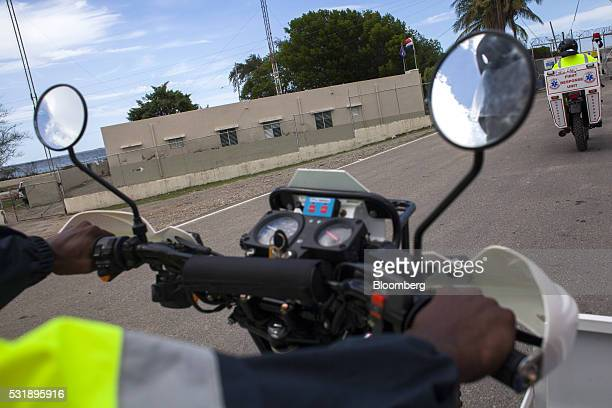 Emergency medical technicians ride USAID donated motorcycles through Manzanillo Monte Cristi Province Dominican Republic on Tuesday May 10 2016...