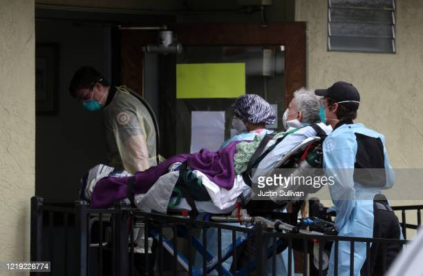 Emergency medical technicians with Royal Ambulance move a patient on a gurney from an ambulance into the Gateway Care and Rehabilitation Center on...