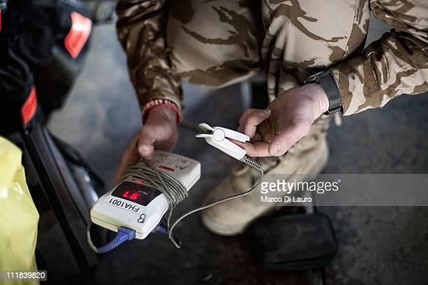 Emergency Nurse Commanding Officer of the MERT, FLT LT Fiona McGlynn, 37-years-old from the Selly Oak Hospital in Birmingham checks the Pulse...