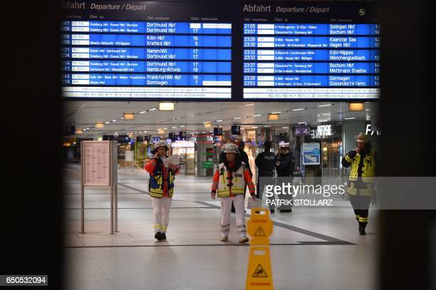 Emergency personal secure a crime scene after an axe attack on passengers at the main train station on March 9 2017 in Duesseldorf Germany Attackers...