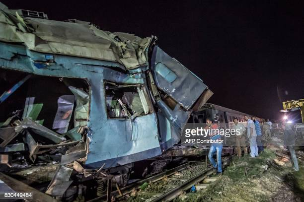 Emergency personnel and Egyptian military police search the wreckage of the train collision on August 11 2017 near Khorshid station in Alexandria At...