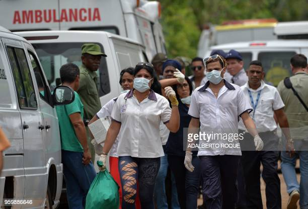 Emergency personnel at seen at the site of the accident after a Cubana de Aviacion aircraft crashed after taking off from Havana's Jose Marti airport...