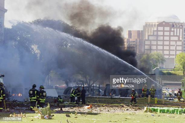 Emergency personnel battle a fire at the Pentagon in Washington, DC, 11 September, 2001 after an airplane crashed into it. At the same time, two...