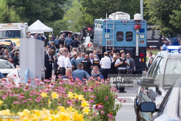 Emergency personnel congregate outside the CapitalGazette newspaper building on June 28 2018 in Annapolis Maryland Five people were killed when a...