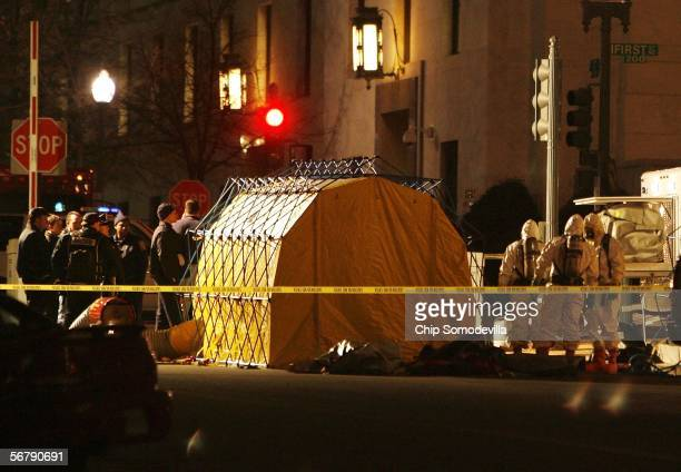 Emergency personnel dressed in HazMat suits work outside the Russell Senate Office Building February 8, 2006 in Washington, DC. A test indicated that...