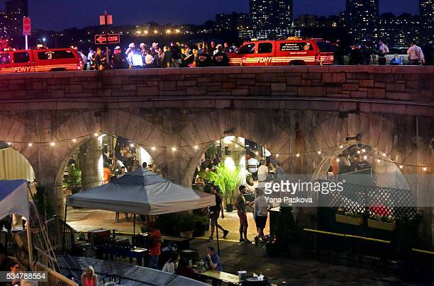 Emergency personnel gathers near the 79th St Boat Basin of the Hudson River into which a vintage World War II plane crashed near New Jersey's...