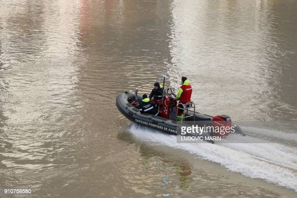 Emergency personnel patrol the flooded Seine River on January 26 2018 in Paris Leaks were starting to appear on January 26 in the basements of Paris...