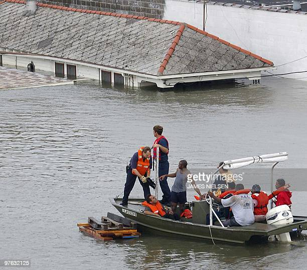 Emergency personnel rescue residents from submerged houses in New Orleans 29 August 2005 after Hurricane Katrina made landfall Hurricane Katrina made...