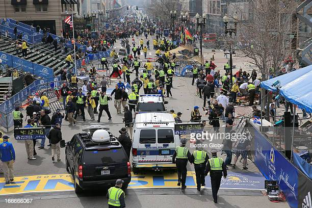 Emergency personnel respond to the scene after two explosions went off near the finish line of the 117th Boston Marathon on April 15 2013