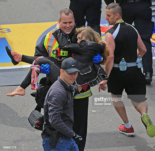 Emergency personnel respond to the scene after two explosions went off near the finish line of the 117th Boston Marathon on April 15 2013 Victim...