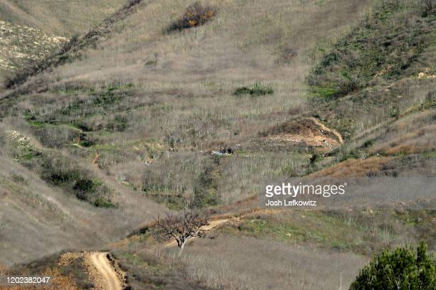 Emergency personnel work at the helicopter crash site that claimed the life of former NBA great Kobe Bryant on January 27, 2020 in Calabasas,...