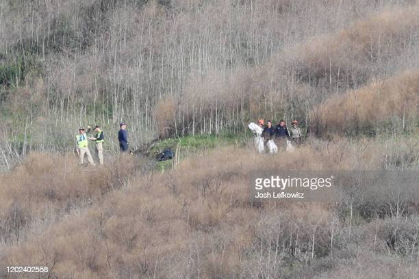Emergency personnel work at the helicopter crash site that claimed the life of former NBA great Kobe Bryant on January 27 2020 in Calabasas...
