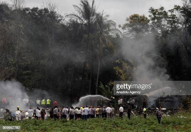 Emergency personnel work at the site of the accident after a Boeing 737 aircraft with more than 100 passengers aboard crashed shortly after take off...