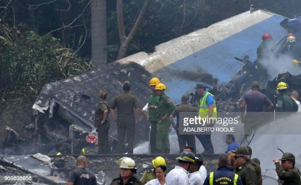 Emergency personnel work at the site of the accident after a Cubana de Aviacion aircraft crashed after taking off from Havana's Jose Marti airport on...
