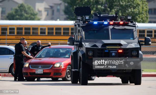 Emergency personnel work the scene in the parking lot at Timberview High School after a shooting on campus on October 6, 2021 in Arlington, Texas....