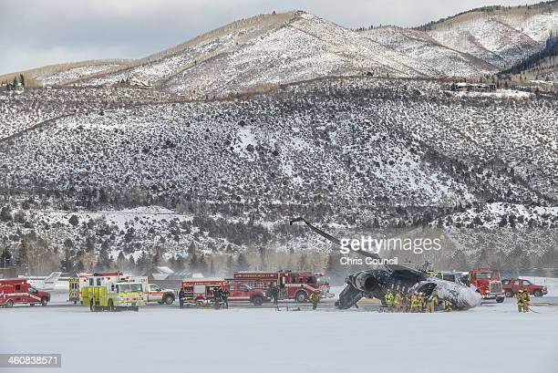 Emergency personnel work to free victims following a plane crash at the AspenPitkin County Airport on January 5 2014 in Aspen Colorado According to...