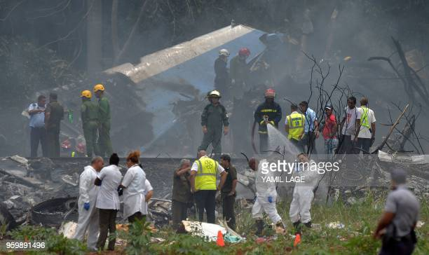 TOPSHOT Emergency personnel works at the site of the accident after a Cubana de Aviacion aircraft crashed after taking off from Havana's Jose Marti...