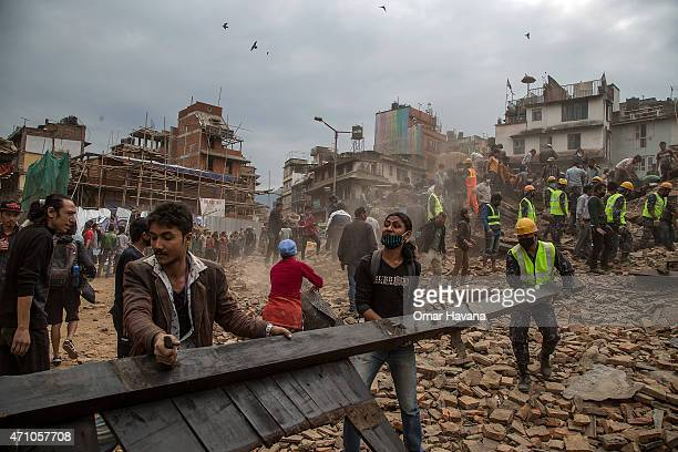 Emergency rescue workers clear debris in Basantapur Durbar Square while searching for survivors on April 25, 2015 in Kathmandu, Nepal. More than 100...