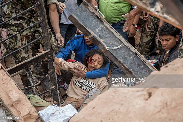 Emergency rescue workers find a survivor in the debris of Dharara tower after it collapsed on April 25 2015 in Kathmandu Nepal More than 100 people...