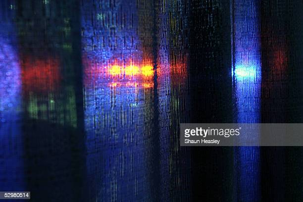 Emergency responder lights are seen through a curtain at GOVSEC the Government Security Expo and Conference at the Washington Convention Center May...