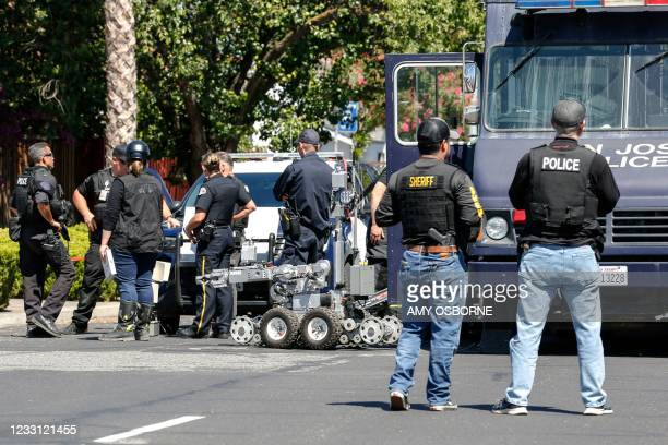 Emergency responders and San Jose Bomb Squad respond to a fire at the house of the suspect of a shooting, after nine people were reported dead...