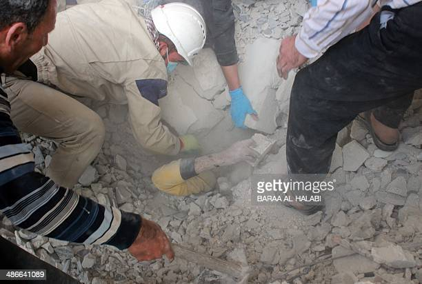 Emergency responders rescue a man buried under rubble after a building collapsed following a reported barrelbomb attack on the northern Syrian city...