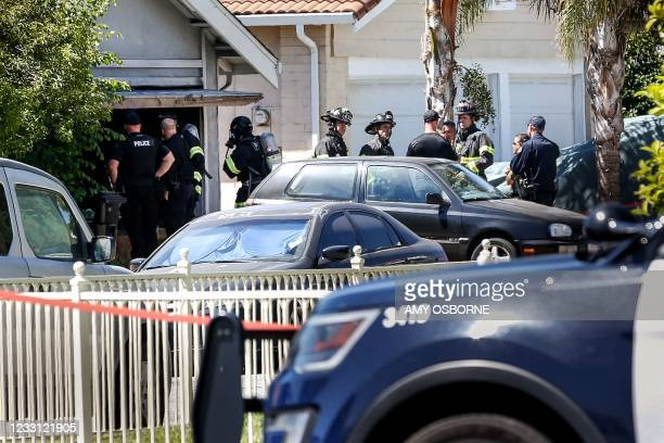 Emergency responders respond to a fire at the house of the suspect of a shooting, after nine people were reported dead including the shooter on May...