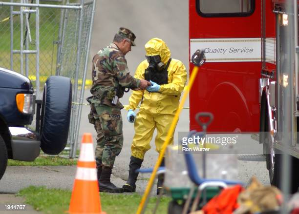 Emergency responders stand outside a US postal facility April 22 2003 in Tacoma Washington The mail distribution facility was evacuated earlier after...