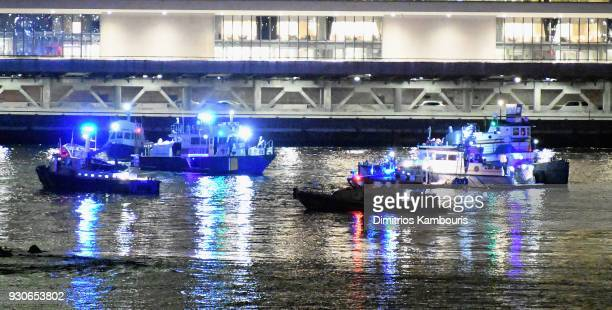 Emergency responders work at the scene of a helicopter crash in the East River March 11 2018 in New York City According to reports at least two...