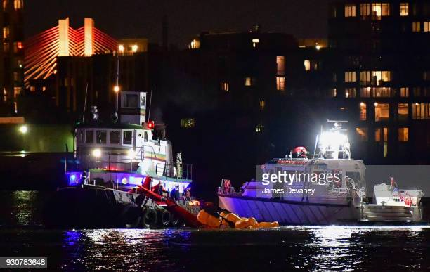 Emergency responders work at the scene of a helicopter crash in the East River March 11 2018 in New York City Five people have died after the...