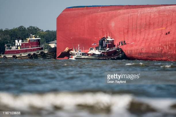 Emergency responders work to rescue crew members from a capsized cargo ship on September 9, 2019 in St Simons Island, Georgia. A 656-foot vehicle...