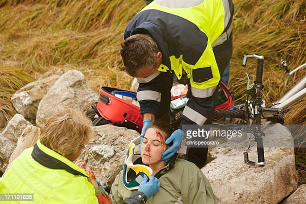 emergency response team attending injured woman - medevac stock photos and pictures