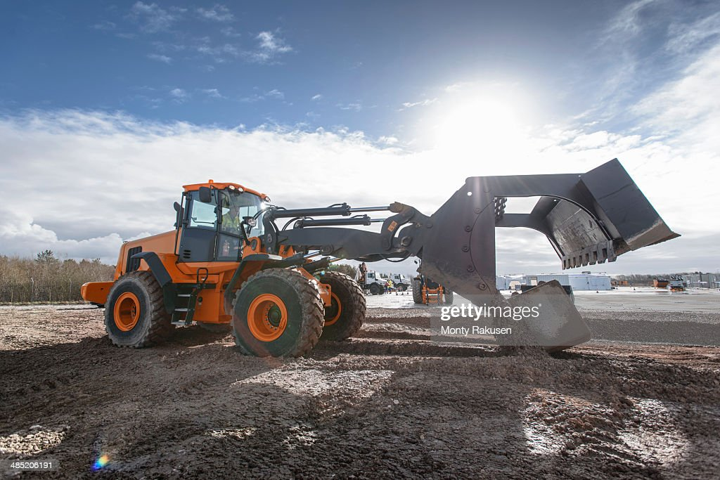 Emergency Response Team digger lifting blocks in training exercise : Stock Photo
