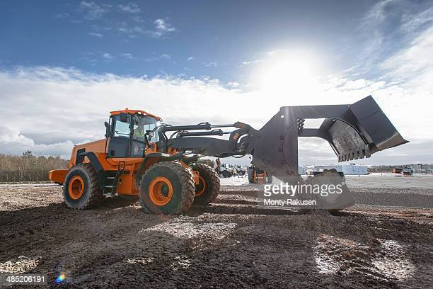 emergency response team digger lifting blocks in training exercise - monty shadow stock photos and pictures