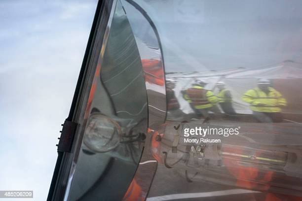 emergency response team reflected in glass of lamp - monty rakusen stock pictures, royalty-free photos & images