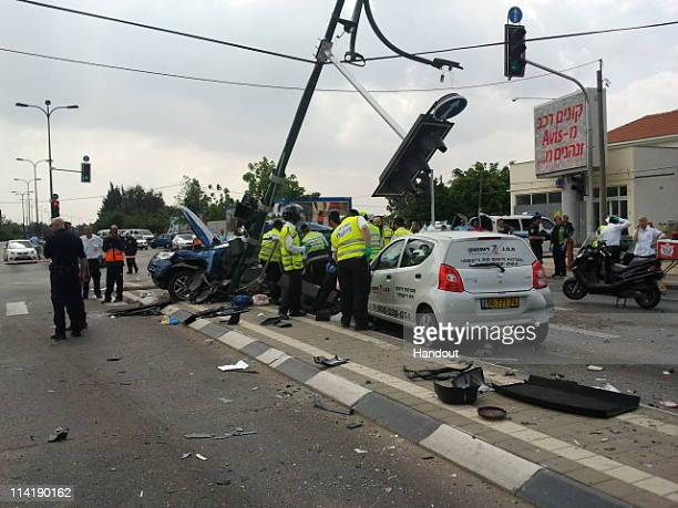 ZAKA emergency response team volunteers attend the scene where one person was killed and 16 others injured after a truck crashed into a bus several...