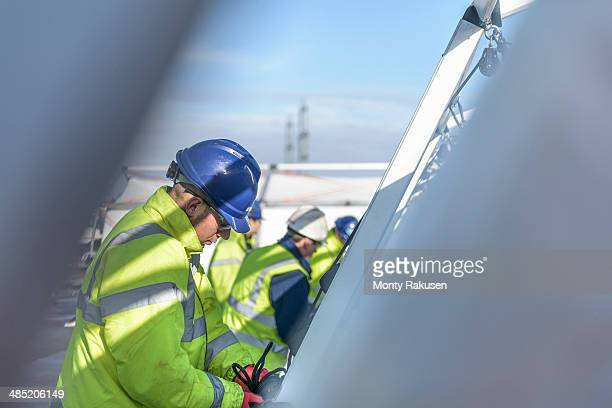 emergency response team workers erecting tent control centre - monty shadow stock photos and pictures