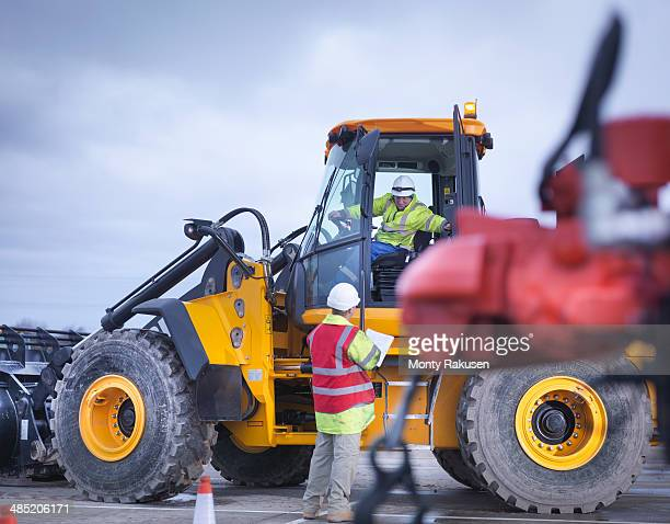 Emergency Response Team workers training with digger