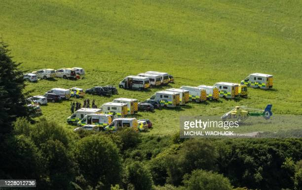 Emergency response vehicles are parked near the scene of a train crash by Stonehaven in northeast Scotland on August 12, 2020. - A passenger train...