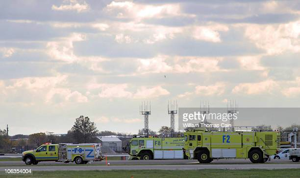 Emergency response vehicles stand by as a UPS cargo plane rests on the tarmac after a suspicious package was found onboard October 29 2010 at...