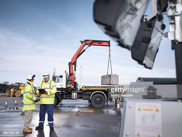 Emergency Response workers training with truck crane