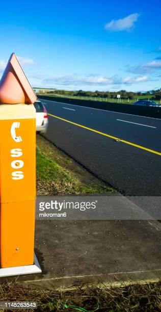 sos emergency road telephone box - sos ストックフォトと画像