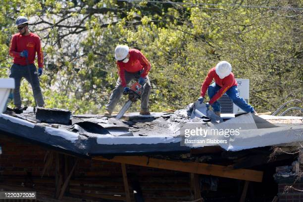 emergency rooftop repair - basslabbers, bastiaan slabbers stock pictures, royalty-free photos & images