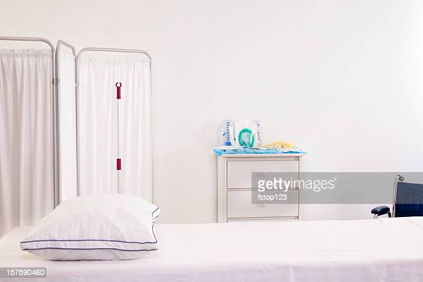 Emergency room or doctor's office with bed partician and wheelchair