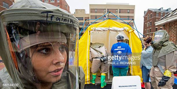 Emergency room personal from MedStar Georgetown University Hospital conduct a decontamination disaster drill in the Washington DC on May 18 in...