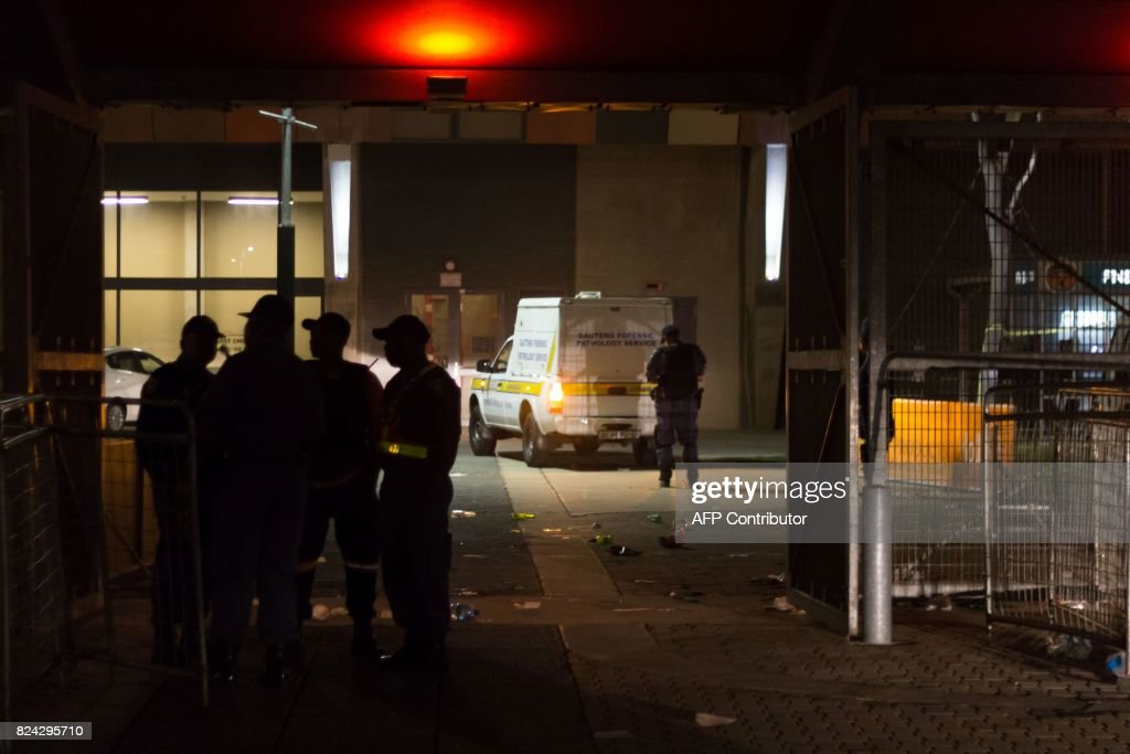 Emergency service and Forensic pathology vehicles leaves the