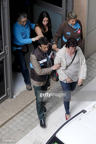 Emergency Service members accompany two women at the Joan Fuster Institue in Barcelona on April 20 2015 after a student allegedley broke into the...